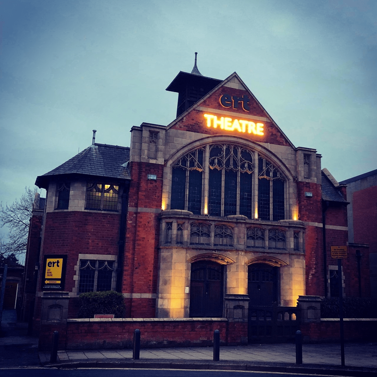 Image of the East Riding theatre building at night, illuminated by lights.